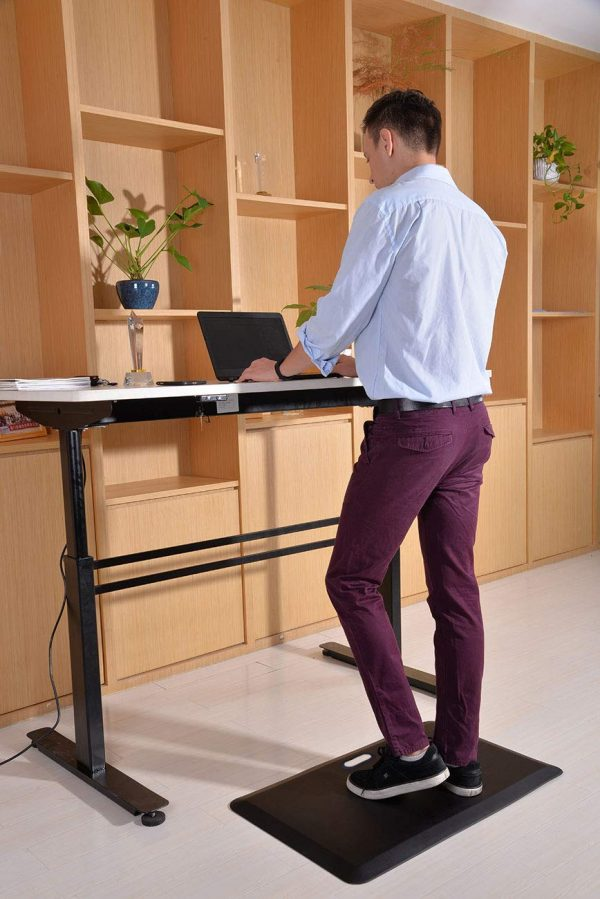 Boy using Stance Anti-Fatigue Mat in a work setting