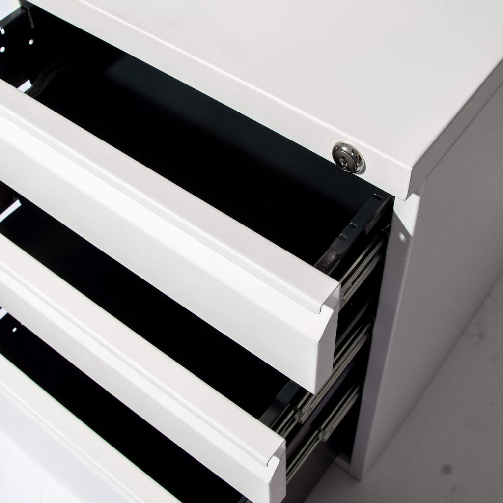 opened drawers close up - white pedestal