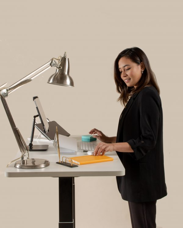 Productive Woman Working on Standing Desk